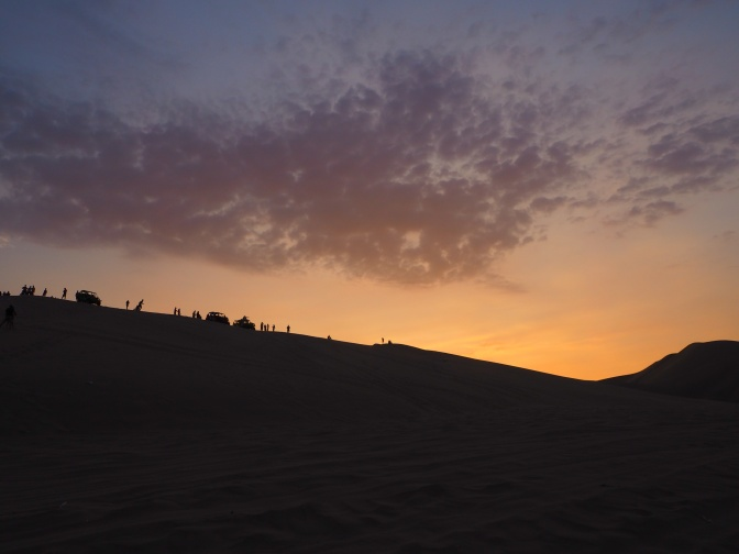 Sandboarders was the sunset on the dunes of Hucachina